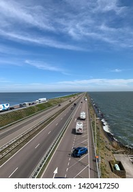 A view of the Afsluitdijk in the Netherlands. The highway seperates the water. Left there is the salty water from the Waddenzee and on the right side is the sweet water from the IJsselmeer.