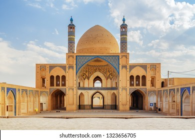 View of Agha Bozorg Mosque on blue sky background in Kashan, Iran. Gorgeous Islamic architecture. The historical mosque and madrasa is a popular tourist attraction of the Middle East.