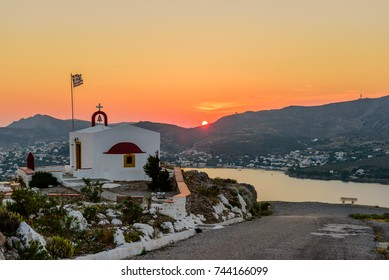 View of Agia Marina village with the Church on top of a hill on Leros island in Greece at sunset