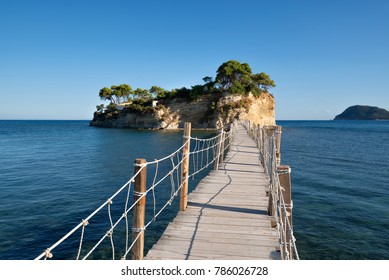 View from Agios Sostis and Cameo island. A beautiful small island with wooden bridge and turquoise water. Zakynthos Greece.