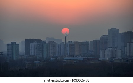 View of air polluted city of Beijing during sunset
