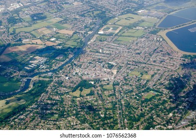 View from the air of the riverside town of Walton-on-Thames in the Surrey borough of Elmbridge.  The Queen Elizabeth II storeage reservoir helps provide water for the many residents of London.