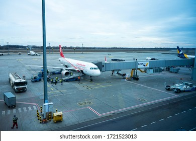 View of the aircraft parking at the airport. The plane is being prepared for departure by airport staff. Kyiv /Ukraine - 02.04.2020