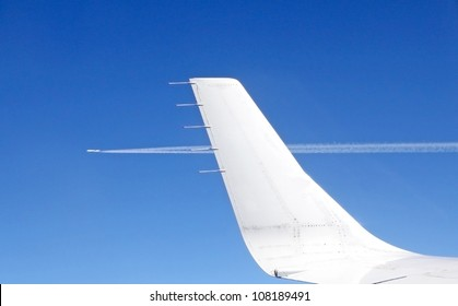 View from an aircraft window on a parallel plane