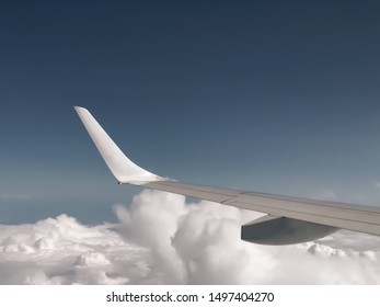 A view of aircraft wings taken inside of the airplane.