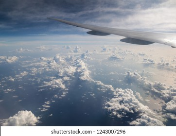 View from airplane to beautiful clouds above the ocean