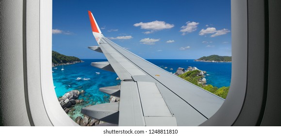 View from airplane. Flight window. Vacation destinations. Tropical beach.  Travel concept.