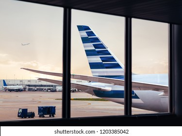 View of airplane fuselage tail with cargo through window at airport