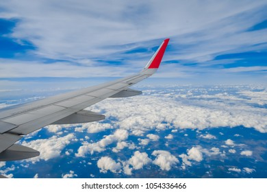 View from airplane window of alps and blue sky on nice sunny day. Wing aircraft in altitude during flight. Sky, Aircraft Wing, Backgrounds, Cloud, Wing. Traveling concept.