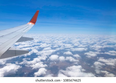 View from airplane window, beautiful cloud group and blue sky on nice sunny day. Wing aircraft in altitude during flight. Sky, Aircraft Wing, Backgrounds, Cloud, Wing. Traveling concept.