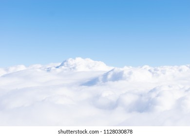 A view from airplane window on beautiful blue sky and clouds
