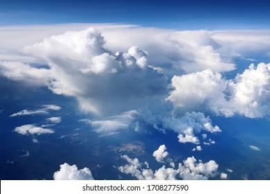 View from airplane window on clouds of different forms