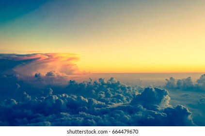 View from airplane window to see sky on evening time. (vintage tone)