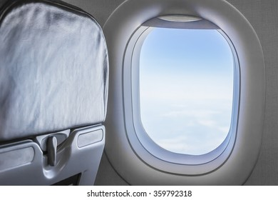 view from an airplane window at the sky