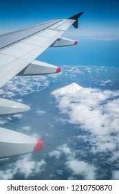 View from Airplane Window with Wing Flying over Mount Egmont in Taranaki New Zealand