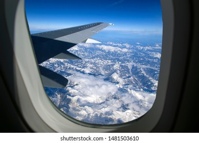 View of airplane wing, clouds and the Earth from the airplane