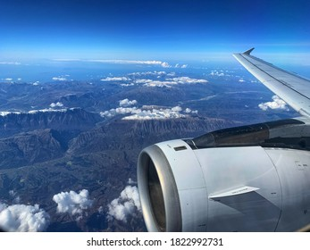 view of airplane wing flying over Albania mountains