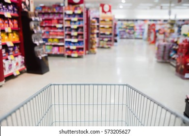 View of the aisle from a trolley at the supermarket