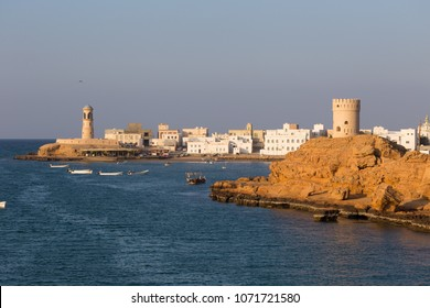 View of the Al Ayjah town, watchtower and lighthouse in the bay of Sur, Oman