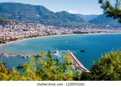 View of Alanya from the fortress on the mountain. View of the tower of Kizil Kule, Alanya port and the lighthouse. Mediterranean sea. Alanya. Antalya Region. Turkey