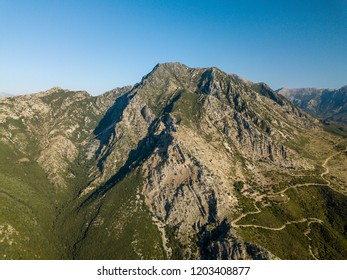 View of Albanian alps and windy road (Borsh, Albania)