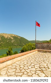 View of the Albanian flag located on a hill in the Butrint National Park, south Albania