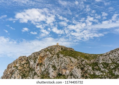 View of the Albercutx watchtower standing on the top of a mountain against a beautiful sky in Cap de Formentor, Mallorca