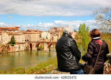 38a3e1bcb9d5 View of Albi (France). Senior couple admiring river view in medieval town of