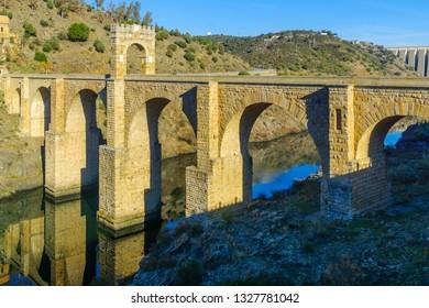 View of the Alcantara Bridge, a Roman stone arch bridge built over the Tagus River, in Extremadura, Spain