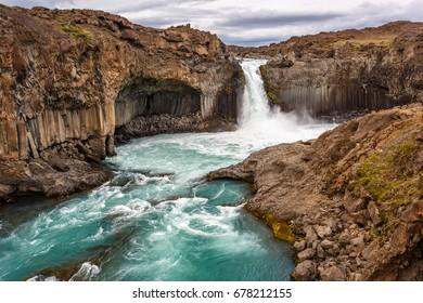 View of Aldeyjarfoss waterfall among the rocks in Iceland