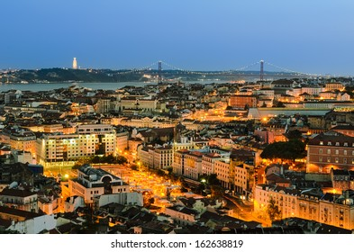 A view of the Alfama downtown and the 25 de Abril Bridge in Lisbon, Portugal