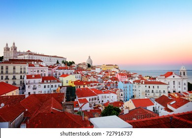 view of Alfama old town district at pink sunset, Lisbon, Portugal, retro toned