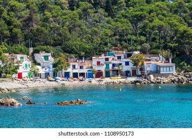 View of Alguer beach with people bathing in Costa Brava, Girona, Catalonia, Spain