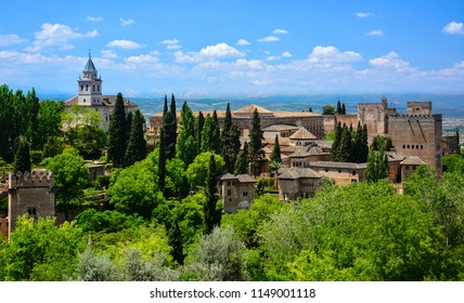 View of Alhambra, a medieval palace and fortress complex in Granada, Andalusia, Spain, from the Generalife gardens. Alhambra is a popular tourist attraction