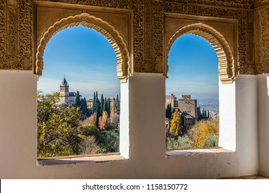 View of the Alhambra through a window at Generalife (Granada, Spain)
