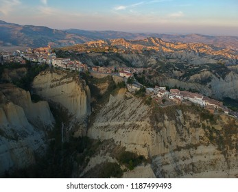 view of Aliano, a town in the province of Matera, in the Southern Italian region of Basilicata, Italy. Famous for the typical calanchi landscape. Aerial view