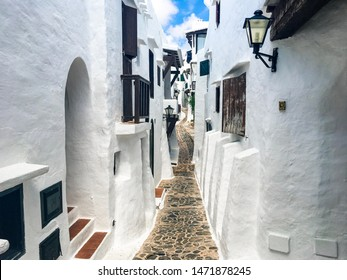 View of the alleys of the fishing village of Binibeca Vell, Menorca, Spain.