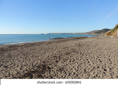 A view along the beach from Downderry to Looe in Southeast Cornwall, on a sunny WInter day