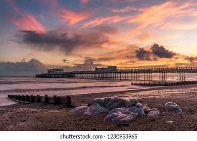 A view along the beach and out to sea at Worthing, Sussex, UK at sunset
