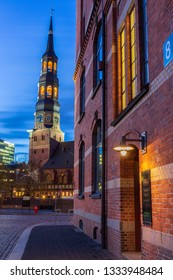 view along the Building of Hamburg Port Authority in Speicherstadt UNESCO Site to the St. Katharin's Church