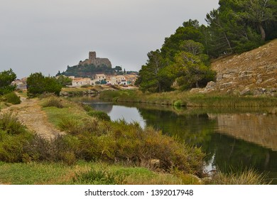View along a drainage canal towards Barbarousse Castle, Gruissan