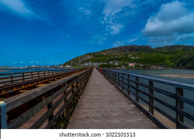 View along length of the footpath of the Barmouth rail bridge, Gwynedd, North Wales, UK.