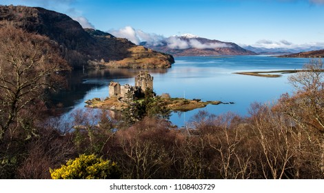 The view along Loch Alsh to the mountains of Skye in the distance with the old 13th century castle of Eilean Donan sitting on a small island