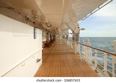 View along the promenade deck of a luxury cruise liner