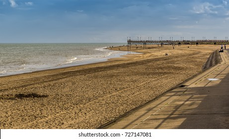 A view along the promenade of Skegness beach, UK on a late autumn afternoon