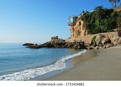 View along the quiet beach, Nerja, Costa del Sol, Malaga Province, Andalucia, Spain.