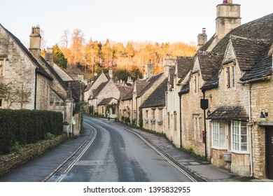 A view along the scenic streets of Castle Combe showing the traditional architecture and quiet streets.
