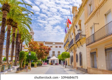 A view along the side of Plaza de la Laguna with the town hall on the right, looking at Parroquia de las Angustias church in Ayamonte, Andalusia, Spain