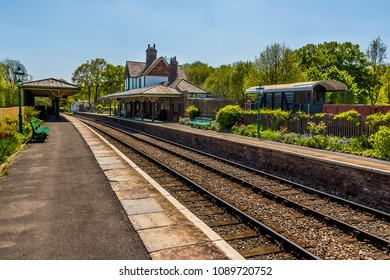 A view along a station on the Bluebell railway in Sussex, UK on a sunny summer day
