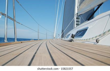 View along teak deck on sailboat